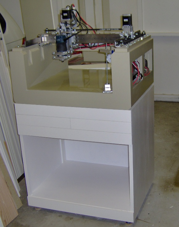 CNC machine on cabinet